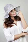 Brunette woman with hat Royalty Free Stock Photo