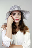 Brunette woman with hat Stock Photos