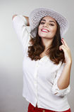 Brunette woman with hat Royalty Free Stock Image