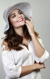 Brunette woman with hat Royalty Free Stock Images