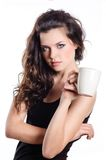 Brunette woman having cup of tea Royalty Free Stock Image