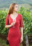 Brunette woman having fun in the vineyards. stock photo