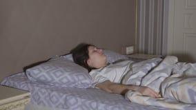 Brunette woman having a nightmare. Restless dreams.  stock footage