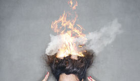 Brunette woman head hair on fire in flames Royalty Free Stock Photos