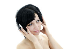 Brunette woman with headphones Royalty Free Stock Images