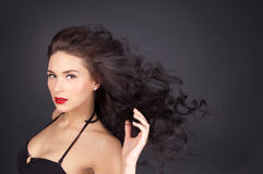 Brunette woman with her hair in movement Stock Images