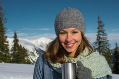 Brunette woman hoding thermos Stock Photography
