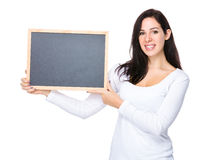 Brunette woman hold with black board Stock Photos