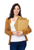 Brunette woman hold with folder Royalty Free Stock Photos