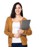 Brunette woman hold with laptop computer Royalty Free Stock Image