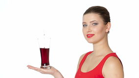 Brunette woman holding a glass of cherry juice stock video footage