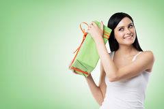 A brunette woman is holding a green gift box. Royalty Free Stock Image