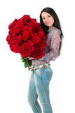 Brunette woman holding a large bouquet of red rose Royalty Free Stock Photo