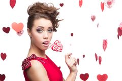 Brunette woman holding lollipop Royalty Free Stock Images