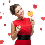 Brunette woman holding lollipop Royalty Free Stock Photography