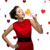 Brunette woman holding lollipop Royalty Free Stock Photo