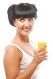 Brunette woman holding orange juice Stock Images