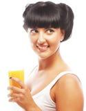Brunette woman holding orange juice Stock Photo