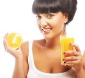 Brunette woman holding orange juice Royalty Free Stock Image