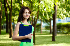 Brunette woman holding tablet Stock Photo