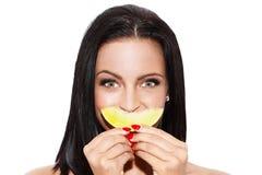 Brunette woman holding yellow melon Stock Image