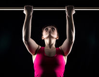 Brunette woman and horizontal bar Royalty Free Stock Photography
