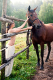 Brunette woman with horse Stock Photo