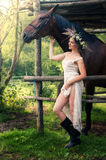 Brunette woman with horse Stock Photos