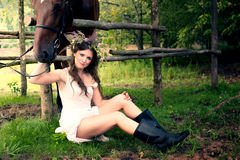 Brunette woman with horse Royalty Free Stock Photo