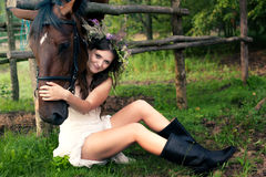 Brunette woman with horse Stock Photography