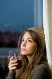 Brunette woman with hot tea. Stock Photos