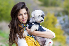 Brunette woman hugging  her white  dog outdoor Stock Photography
