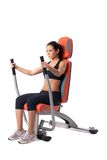 Brunette woman on hydraulic exerciser Royalty Free Stock Photography