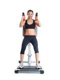 Brunette woman on isodynamic exerciser Royalty Free Stock Photo