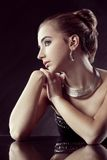 Brunette woman with jewellery Royalty Free Stock Photo