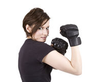 Brunette Woman Kick Boxer Smiling. Brunette woman in boxing attire serious stance royalty free stock photo
