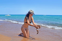 Brunette woman at Koroni beach Peloponnese Greece Royalty Free Stock Photos