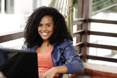 Brunette woman with laptop on hammock Royalty Free Stock Photo