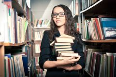 Brunette woman at library Royalty Free Stock Images