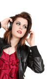 Brunette woman listening to music with headphones Royalty Free Stock Photos