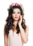 Brunette Woman with Long Curly Hair and Spring Flowers stock image