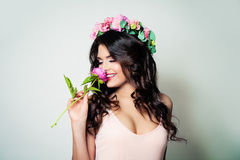 Brunette Woman with Long Curly Hair and Spring Flowers royalty free stock photography