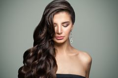 Brunette Woman with Long Healthy Wavy Hair. And Makeup. Dark Hair Female Model. Eyes Closed royalty free stock photo