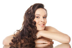 Brunette woman with long wavy hairs on white Royalty Free Stock Photo