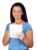 Brunette woman lookin a notebook Stock Photography