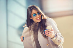 Brunette woman looking at mobile phone outdoor Stock Photos