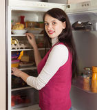 Brunette woman looking in refrigerator Stock Photography