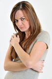 Brunette woman looking sad or pouty Stock Photos