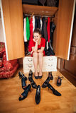 Brunette woman looking at shoes in wardrobe Royalty Free Stock Photography