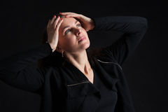 Brunette woman looking up in darkness Stock Photo